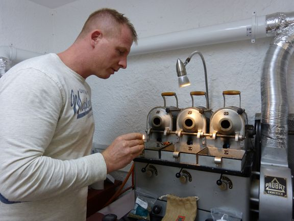Barista Guido roasting samples Tornado cafe
